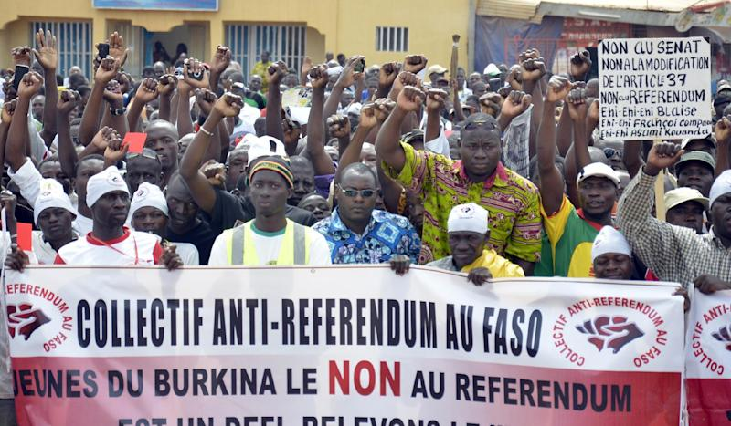 Burkina Faso's opposition supporters hold a banner during an opposition rally in Ouagadougou on August 23, 2014 (AFP Photo/Ahmed Ouoba)