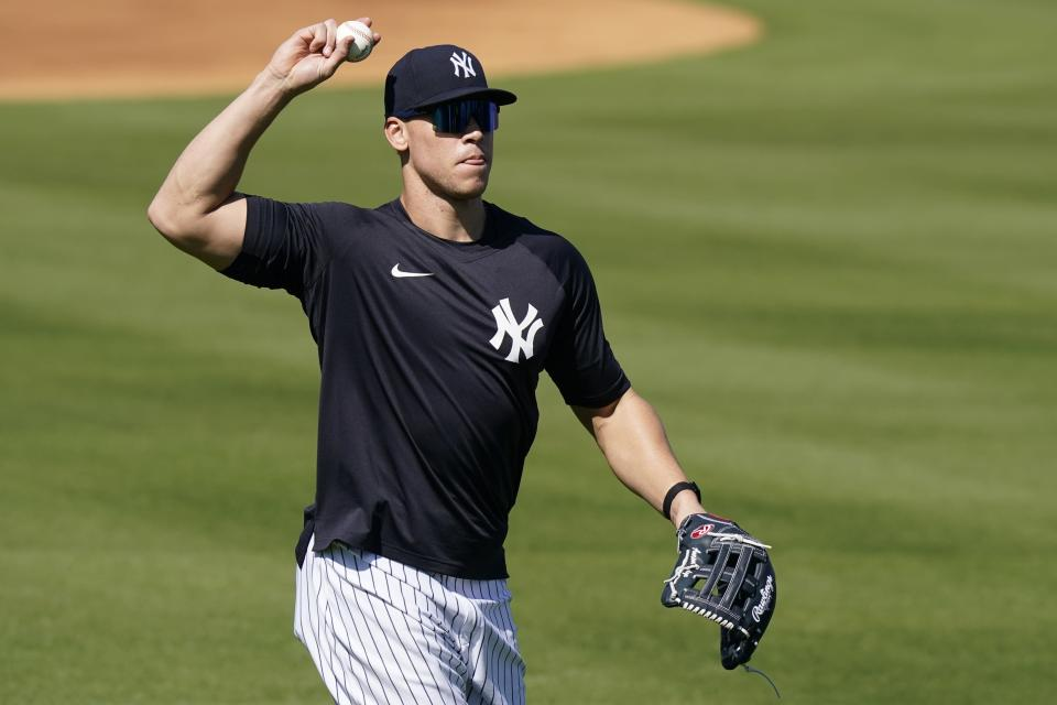 New York Yankees' Aaron Judge throws to a teammate during a spring training baseball workout, Tuesday, Feb. 23, 2021, in Tampa, Fla. (AP Photo/Frank Franklin II)