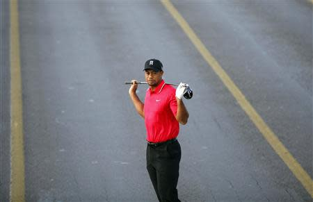 U.S. golfer Tiger Woods poses during an event to promote the upcoming Turkish Airlines Open golf tournament, on the Bosphorus Bridge that links the city's European and Asian sides, in Istanbul November 5, 2013. REUTERS/Osman Orsal