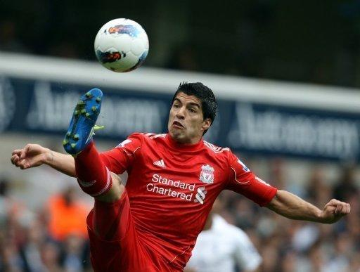 Liverpool's Uruguayan striker Luis Suarez stretches to control the ball