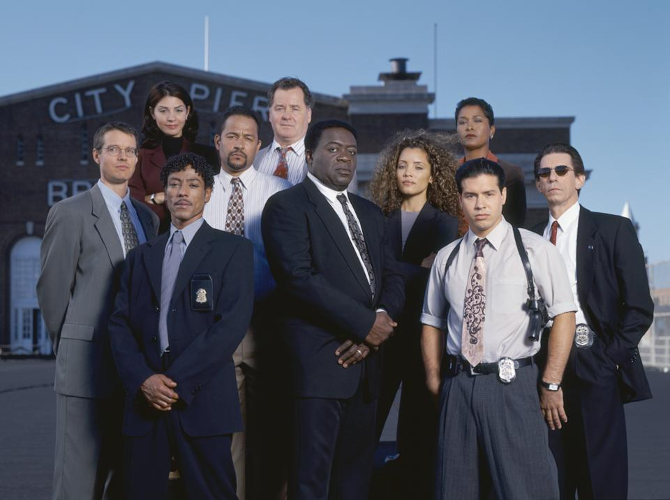 HOMICIDE: LIFE ON THE STREET -- Pictured: (back, l-r) Callie Thorne as Det. Laura Ballard, Peter Gerety as Det. Stuart Gharty, Toni Lewis as Det. Terri Stivers, (center, l-r) Kyle Secor as Det. Tim Bayliss, Clark Johnson as Det. Meldrick Lewis, Clark Johnson as Det. Meldrick Lewis, Michael Michele as Det. Rene Sheppard, (front, l-r) Clayton LeBouef as Col. George Barnfather, Yaphet Kotto as Lt. Al Giardello, Jon Seda as Det. Paul Falsone -- Photo by: NBCU Photo Bank