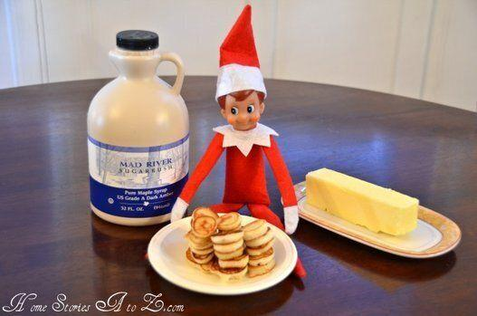 "<p>Have your elf ready and waiting with family breakfast -- including syrup, of course. Make sure there are some tiny pancakes for her too!</p> <p>Source: <a href=""http://www.homestoriesatoz.com/wp-content/uploads/2011/11/elf-on-the-shelf-makes-breakfast.jpg"" target=""_blank"">Home Stories A to Z</a></p>"