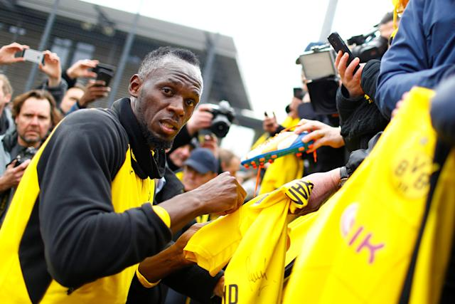Soccer Football - Usain Bolt participates in a training session with Borussia Dortmund - Strobelallee Training Centre, Dortmund, Germany - March 23, 2018 Usain Bolt signs autographs after Borussia Dortmund training REUTERS/Thilo Schmuelgen