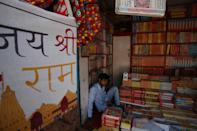 A shop keeper sits inside his book shop near Hanuman Garhi Temple before the arrival of Prime Minister Narendra Modi for Gournd breaking ceremony of Ram Temple ,during the Covid 19 pandemic, in Ayodhya, India on August 4, 2020. (Photo by Ritesh Shukla/NurPhoto via Getty Images)