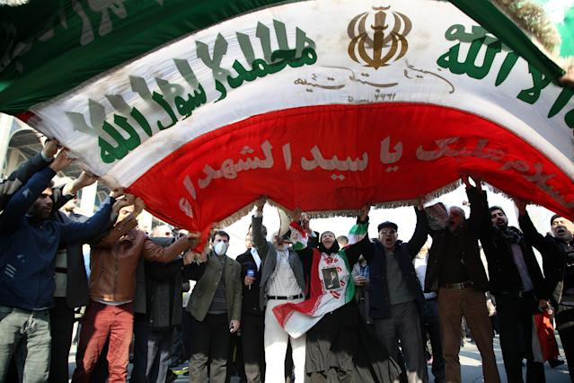 <p>Iranians hold an Iranian flag during a protest after performing the Friday Prayer at Imam Khomeini Mosque followinga U.S. statement about backing the anti-government protests in Tehran, Iran on Jan. 05, 2018. (Photo: Fatemeh Bahrami/Anadolu Agency/Getty Images) </p>
