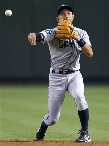 Seattle Mariners' Munenori Kawasaki throws out Arizona Diamondbacks' John McDonald during the second inning of an interleague baseball game, Wednesday, June 20, 2012, in Phoenix. (AP Photo/Matt York)