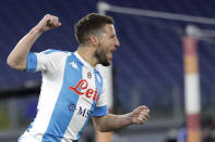 Napoli's Dries Mertens celebrates after scores against Roma during the Italian Serie A soccer match between Roma and Napoli at Rome's Olympic stadium, Sunday, March 21, 2021. (AP Photo/Gregorio Borgia)