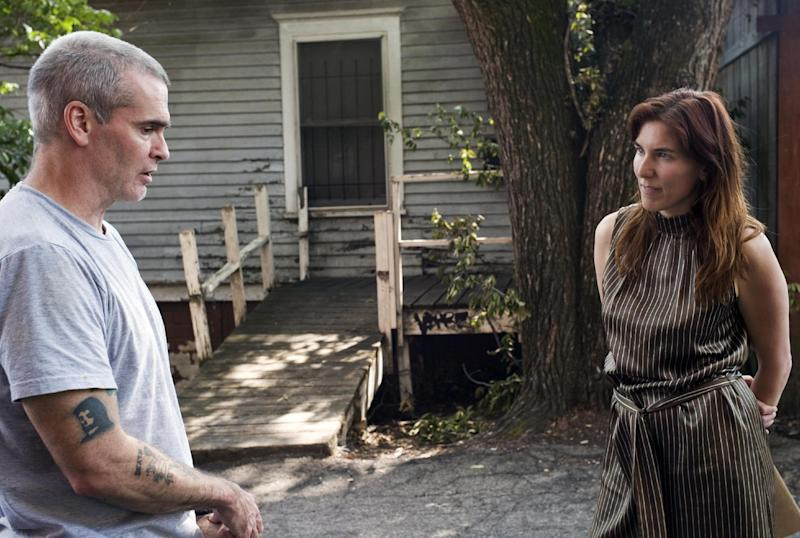 """This undated publicity photo released by Sony Pictures Classics shows Henry Rollins, left, and director Amy Berg in the documentary film, """"West of Memphis."""" (AP Photo/Sony Pictures Classics, Olivia Fougeirol)"""