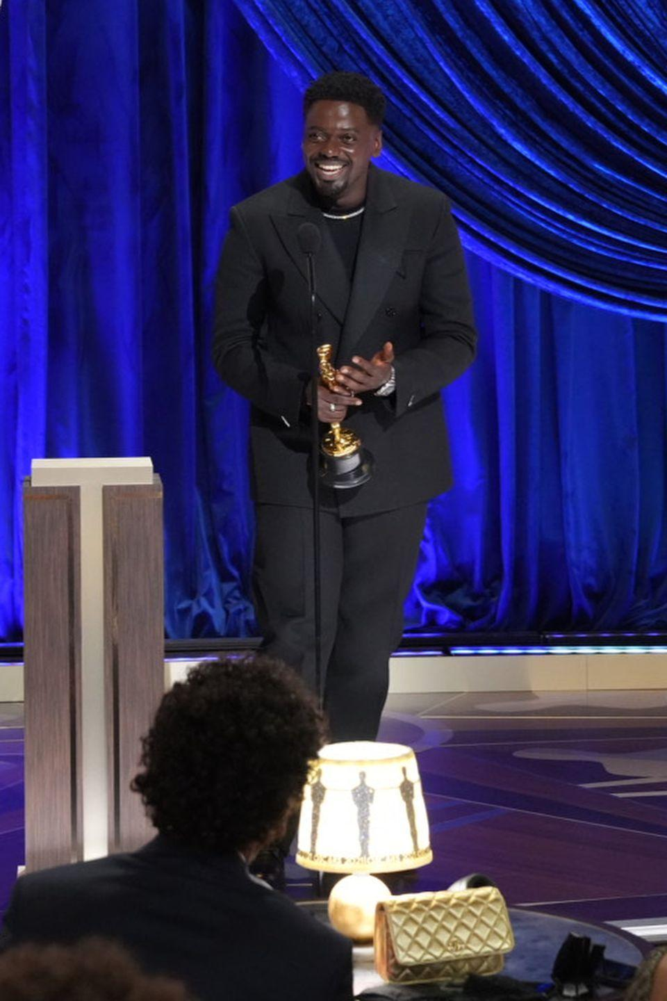 """<p>During the ceremony, the British star <a href=""""https://www.elle.com/uk/life-and-culture/culture/a36222860/daniel-kaluuya-oscar-speech/"""" rel=""""nofollow noopener"""" target=""""_blank"""" data-ylk=""""slk:won the award"""" class=""""link rapid-noclick-resp"""">won the award</a> for Best Supporting Actor for his role in Judas and the Black Messiah and delivered the most hilarious speech. </p><p>'My mum and my dad...they had sex. It's amazing! I'm here!' he said at the end of the speech, much to his mother's embarrassment who was seen looking pretty shocked while watching the ceremony via a video link in London. </p>"""