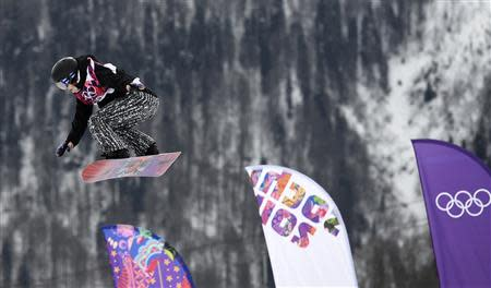 Finland's Enni Rukajarvi performs a jump during the women's snowboard slopestyle finals event at the 2014 Sochi Winter Olympics in Rosa Khutor, February 9, 2014. REUTERS/Dylan Martinez