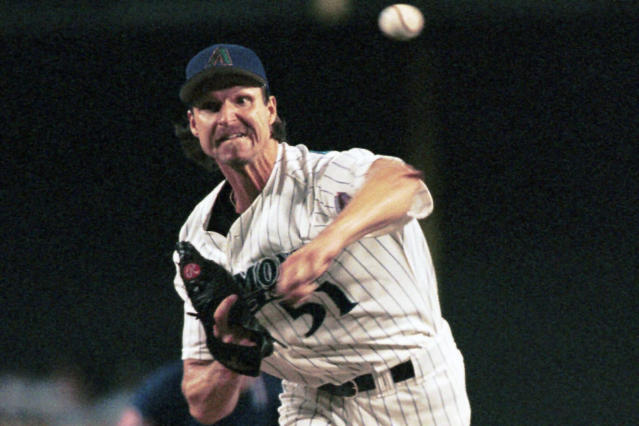 FILE - In this July 15, 2000, file photo, Arizona Diamondbacks' Randy Johnson delivers a pitch during the first inning of a baseball game against the Texas Rangers in Phoenix. Johnson was 10-1 with 139 strikeouts through his first 13 starts over Arizona's first 60 games in 2000, when he won the second of his four consecutive NL Cy Young Awards. (AP Photo/Roy Dabner, File)