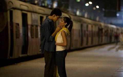 Freida Pinto with ex-partner and co-star Dev Patel in Danny Boyle's 2008 film Slumdog Millionaire