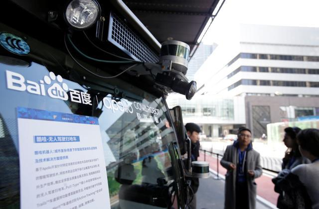 A camera is seen on the head of a self-driving sweeper car with Baidu's Apollo autonomous driving open platform at the 2018 Baidu World conference and exhibit to showcase its latest AI technology in Beijing, China, November 1, 2018. REUTERS/Jason Lee - RC1B1D44A540