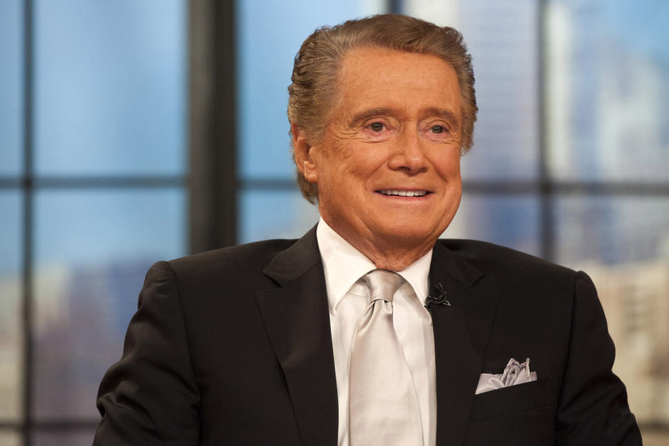 """FILE - In this Nov. 18, 2011 file photo, Regis Philbin appears on his farewell episode of """"Live! with Regis and Kelly"""", in New York. Philbin, the genial host who shared his life with television viewers over morning coffee for decades and helped himself and some fans strike it rich with the game show """"Who Wants to Be a Millionaire,"""" has died on Friday, July 24, 2020. (AP Photo/Charles Sykes, File)"""