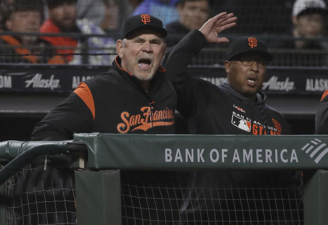 San Francisco Giants manager Bruce Bochy, left, and hitting coach Alonzo Powell react toward an umpire after Brandon Belt struck out against the San Diego Padres during the fifth inning of a baseball game in San Francisco, Monday, April 8, 2019. (AP Photo/Jeff Chiu)