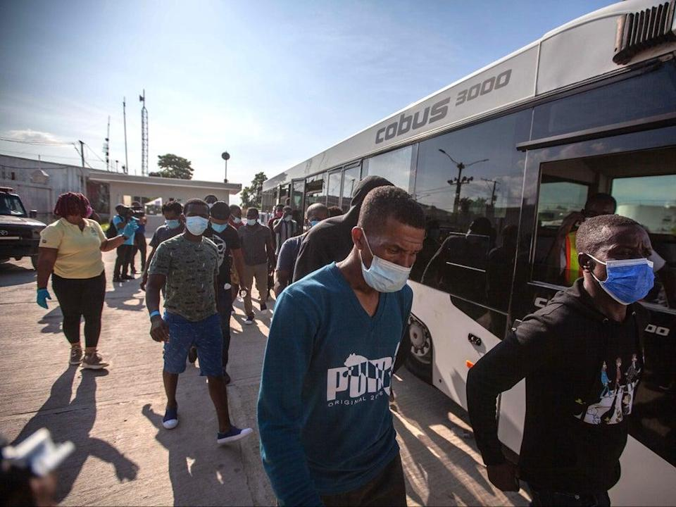 Haitian migrants arriving in Port-au-Prince after deportation from the US (EPA)