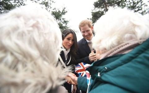 Prince Harry and Meghan Markle meet Irene Gould and June Dickinson - Credit: PA