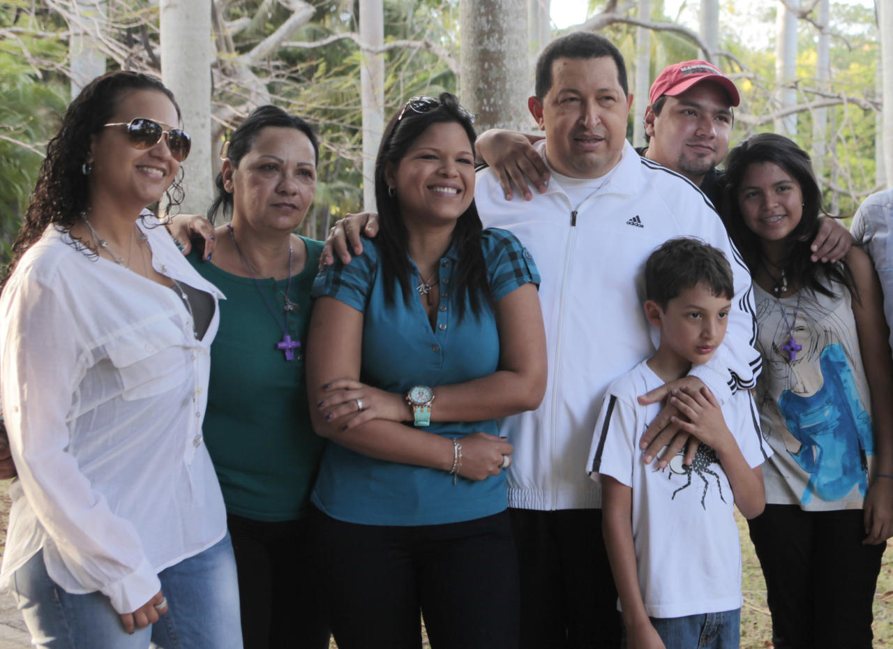 In this photo released by the Miraflores Press Office, Venezuela's President <font>Hugo</font> <font>Chavez</font> is surrounded by his family members including; daughter <font>Rosa</font> <font>Virginia</font>, left, an unidentified woman, daughter Maria Gabriela, third left, son <font>Hugo</font> Rafael Jr. standing behind <font>Chavez</font>, second from right, granddaughter Gabriela, right, and his grandson Manuel, standing in front of <font>Chavez</font>, second right, in Havana Cuba, Monday March 12, 2012. <font>Chavez</font>  said Sunday March 11, 2012, that he plans to return home in the coming  days from Cuba where he has been recovering after undergoing cancer  surgery. (AP Photo/Miraflores Press Office/Marcelo Garcia)