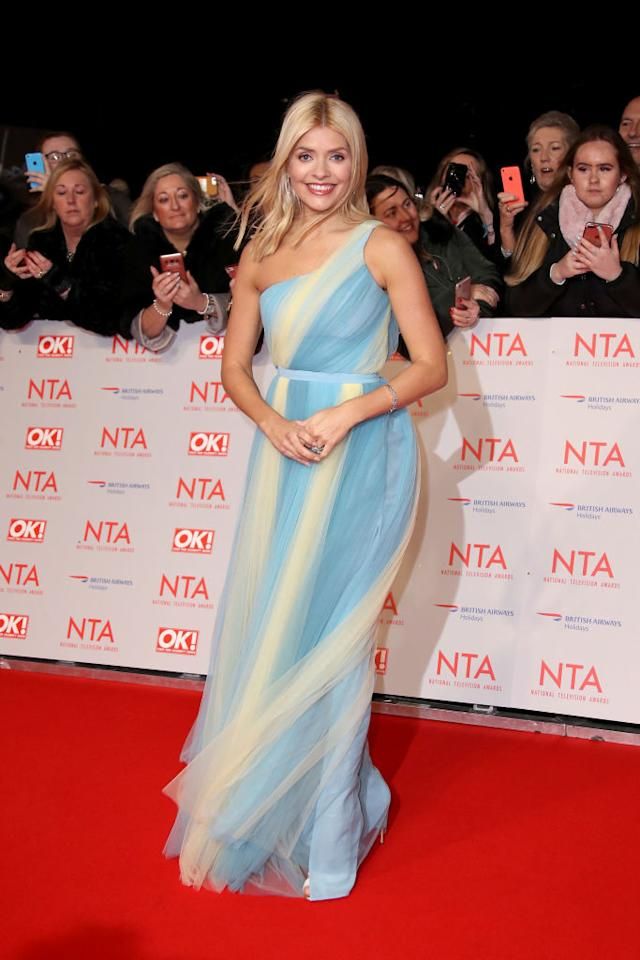 <p>Holly Willougby stole the sartorial spotlight at this year's awards ceremony in a pastel-hued dress by Elisabetta Franchi and finished the look with a pair of heels by Charlotte Olympia. <em>[Photo: Getty]</em><br /><br /></p>