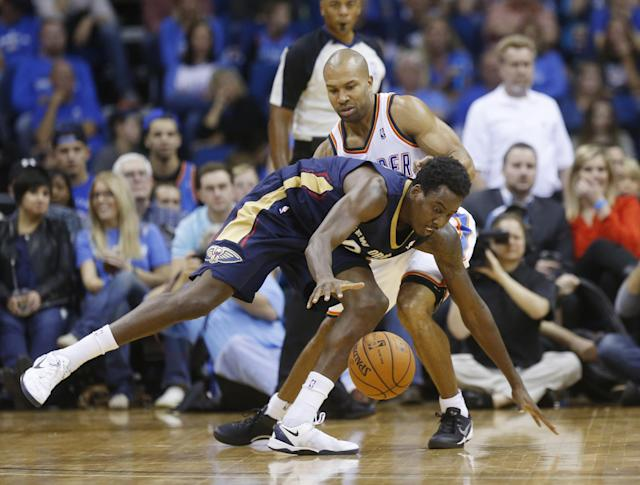 New Orleans Pelicans forward Al-Farouq Aminu (0) reaches for the ball in front of Oklahoma City Thunder guard Derek Fisher in the third quarter of an NBA basketball preseason game in Tulsa, Okla., Thursday, Oct. 17, 2013. New Orleans won 105-102. (AP Photo/Sue Ogrocki)
