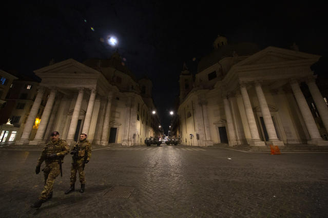 A view of Milan's Via del Corso from Piazza del Popolo with some soldiers in the evening before the entire nation of Italy has been placed under lockdown. (Credit: Giuseppe Fama/Pacific Press/LightRocket via Getty Images)
