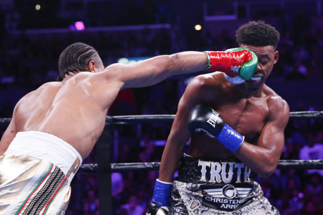 Shawn Porter lands a punch to the face of Errol Spence Jr., during the WBC & IBF World Welterweight Championship boxing match Saturday, Sept. 28, 2019, in Los Angeles. (AP Photo/Ringo H.W. Chiu)