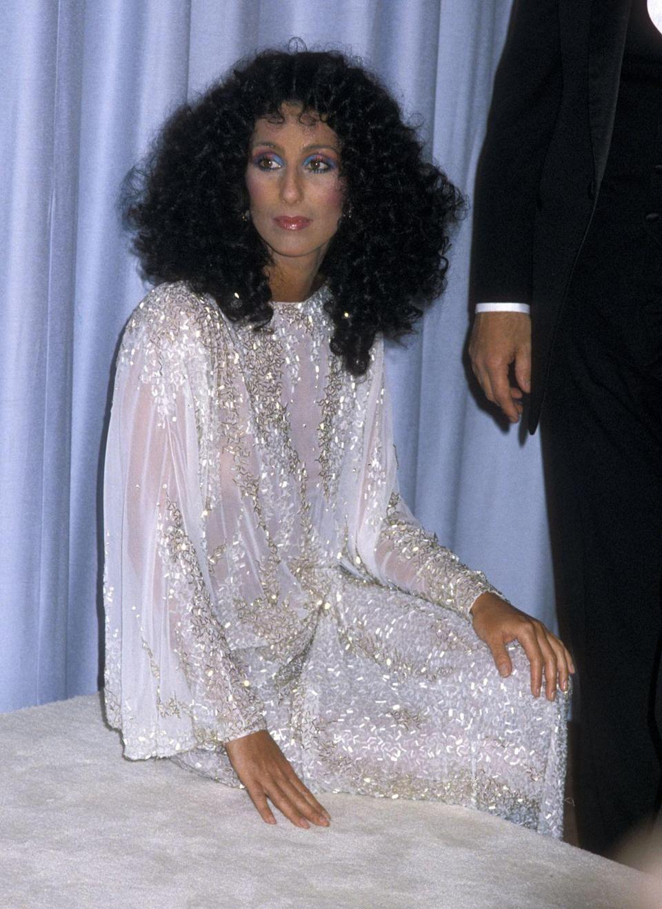 <p>In a sparkling gown and rainbow eye makeup at the Academy Awards.</p>