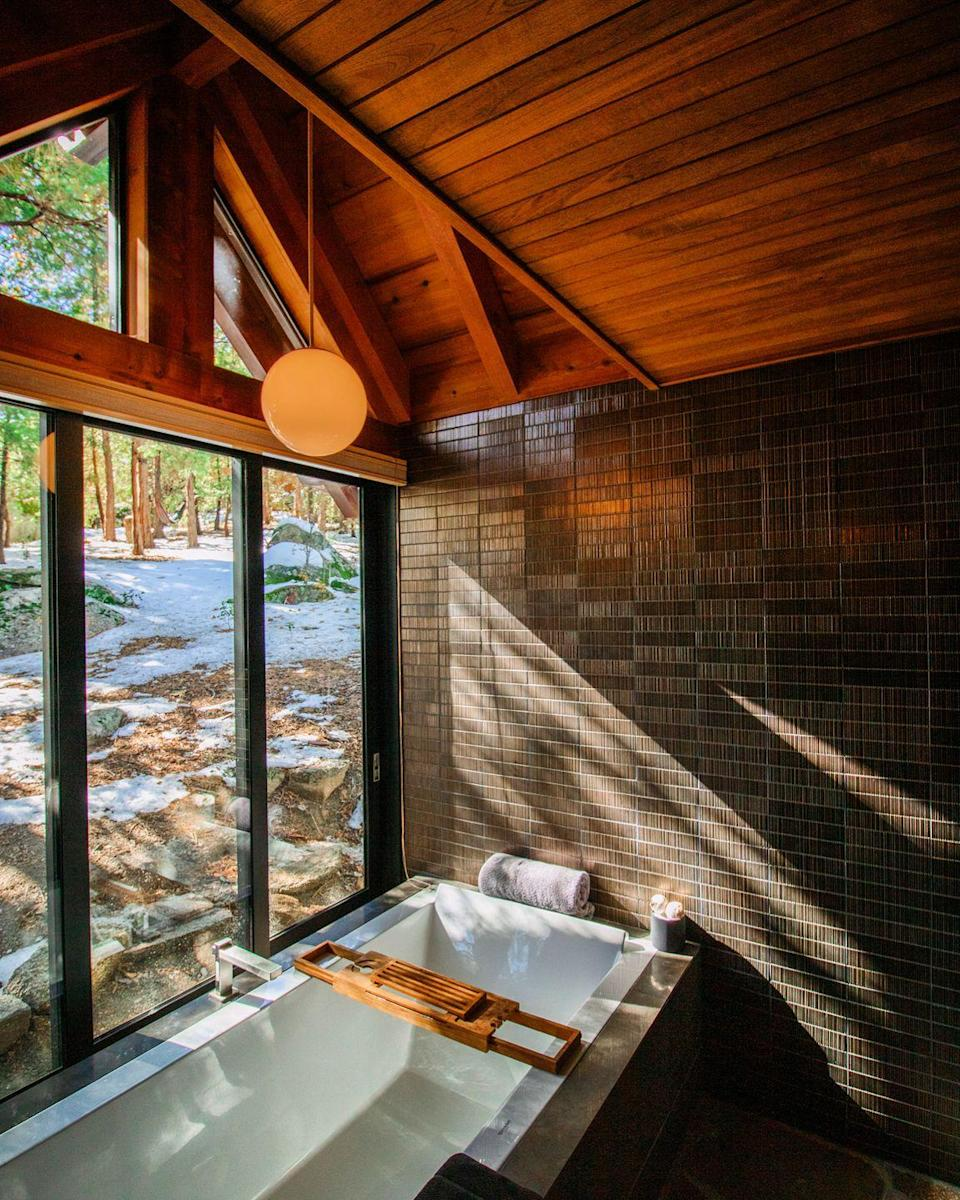 """<p>This cosy 1962 A-frame chalet, which is nestled in the trees of beautiful Idyllwild, is the perfect place to escape the woes of everyday. You'll love the floor-to-ceiling windows, stunning surrounding views, and the grand bathtub. </p><p><a class=""""link rapid-noclick-resp"""" href=""""https://go.redirectingat.com?id=127X1599956&url=https%3A%2F%2Fwww.airbnb.co.uk%2Frooms%2F29515833&sref=https%3A%2F%2Fwww.housebeautiful.com%2Fuk%2Flifestyle%2Fproperty%2Fg35381593%2Fairbnb-most-liked-homes%2F"""" rel=""""nofollow noopener"""" target=""""_blank"""" data-ylk=""""slk:MORE INFO"""">MORE INFO</a></p>"""