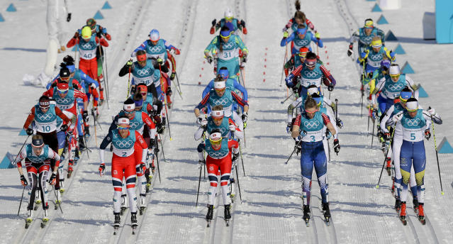 Racers take off at the start of the women's 30k cross-country skiing competition at the 2018 Winter Olympics in Pyeongchang, South Korea, Sunday, Feb. 25, 2018. (AP Photo/Kirsty Wigglesworth)