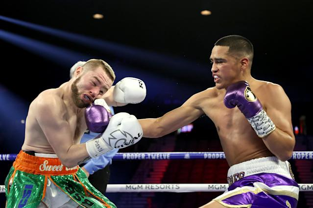 Gabriel Flores Jr. knocks down Matt Conway in the first round during their junior lightweight bout on February 22, 2020 at MGM Grand Garden Arena. (Photo by Al Bello/Getty Images)