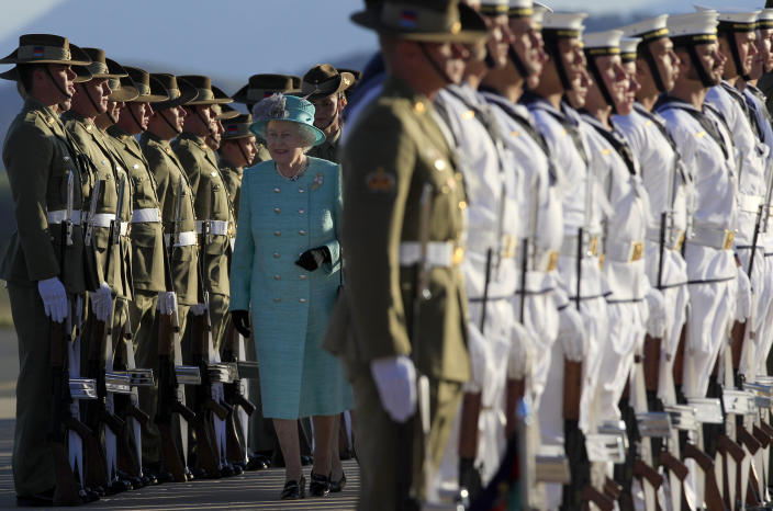 Queen Elizabeth II inspects an honor guard after her arrival at Fairbairn airforce base in Canberra, Wednesday, Oct. 19, 2011. The Queen is on a tour to Australia, her first visit since 2006. (AP Photo/Rick Rycroft)