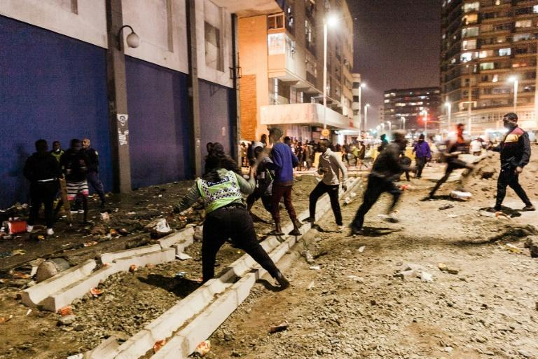 Police clashed with crowds of looters in Durban overnight