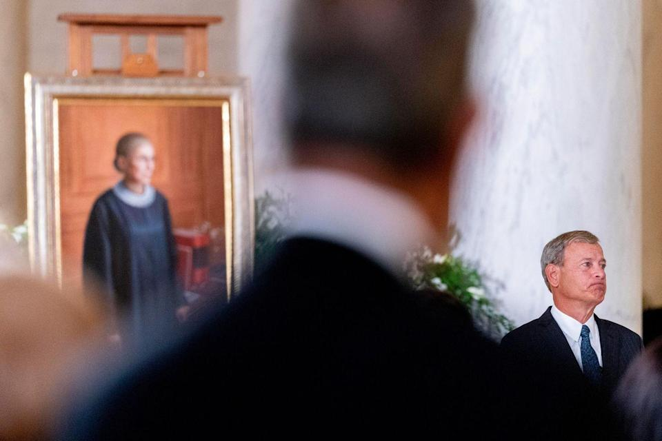 <p>U.S. Supreme Court Chief Justice John Roberts, asks for a moment of silence while speaking during a private ceremony for Associate Justice Ruth Bader Ginsburg at the U.S. Supreme Court, on September 23, 2020 in Washington, DC.</p>