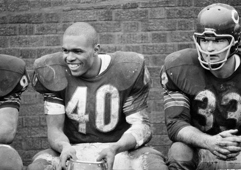 Gale Sayers smiles happily after scoring six touchdowns against San Francisco 49ers as the Bears won, 61-20, in Chicago on Dec. 12, 1965. (AP Photo/Paul Cannon)