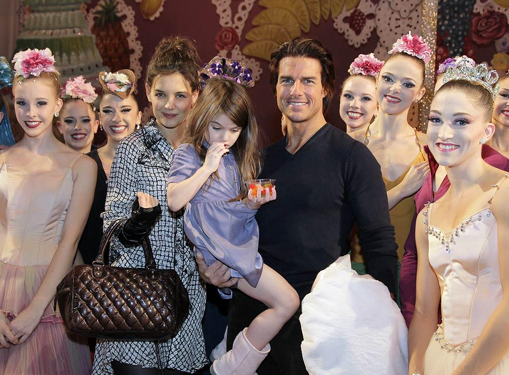 """Tom Cruise and Katie Holmes took their 4-year-old daughter Suri to see the New York City Ballet's holiday production of """"The Nutcracker"""" while in the Big Apple for Katie's 32nd birthday. Amusingly, the precocious tot seems far more interested in her gummy bears than the ballet dancers! Paul Kolnik/I<a href=""""http://www.infdaily.com"""" target=""""new"""">INFDaily.com</a> - December 17, 2010"""