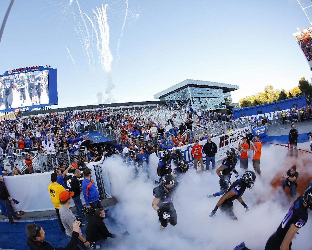The Boise State Broncos run onto the field before an NCAA college football game against Nevada in Boise, Idaho, Saturday, Oct. 19, 2013. (AP Photo/Otto Kitsinger)