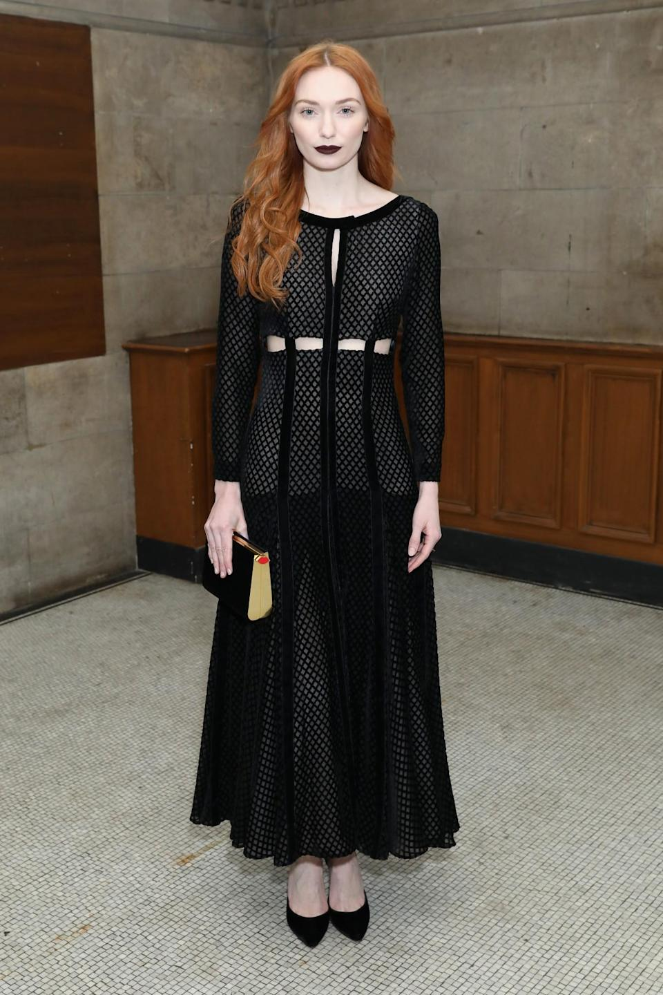 <p>Eleanor Tomlinson was perfectly gothic in a cut-out black gown. <i>[Photo: Getty]</i> </p>