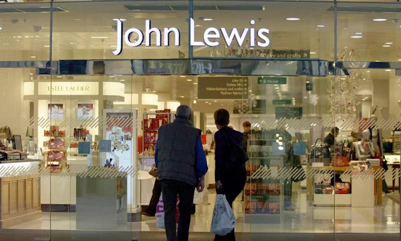 Shoppers enter a John Lewis store in Leicester