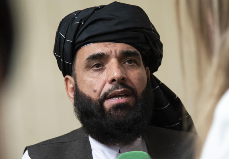 FILE - In this May 28, 2019 file photo, Suhail Shaheen, spokesman for the Taliban's political office in Doha, speaks to the media in Moscow, Russia. Afghanistan's Taliban leaders agreed they wanted a deal with the United States, but some among them were in more of a hurry than others. Even before U.S. President Donald Trump cancelled a mysterious Camp David summit on Saturday, Sept. 7, 2019, the Taliban negotiators were at odds with the council of leaders, or shura, that rules the Islamic movement. (AP Photo/Alexander Zemlianichenko, File)