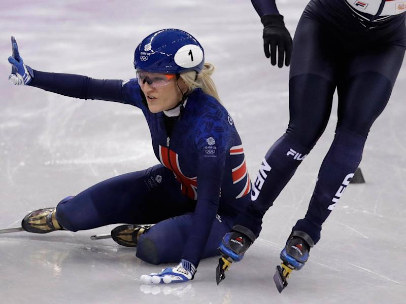 Elise Christie was disqualified from the 1000m short-track speedskating heats (AP)