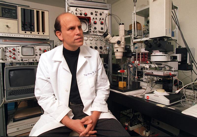 "FILE - In this Friday, March 1, 1996, file photo, Michael Milken, the famed ex-junk bond financier who once was at the center of the biggest Wall Street securities fraud scandal, poses for a photo while visiting the UCLA Nutrition Research Laboratory in the Westwood area of Los Angeles. George Washington University will name its public health school for Michael Milken, the 1980s king of Wall Street ""junk"" bonds who spent 22 months in prison but later devoted himself to philanthropy and advocated for medical research. On Tuesday,  March 11, 2014, the university announced gifts totaling $80 million to address public health challenges from Milken and Sumner Redstone. (AP Photo/Damian Dovarganes)"