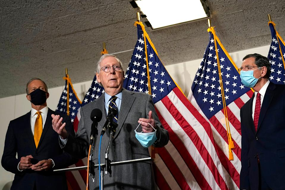Senate Minority Leader Mitch McConnell, R-Ky., center, says he hasn't made up his mind on whether to vote to convict former President Donald Trump at his impeachment trial.