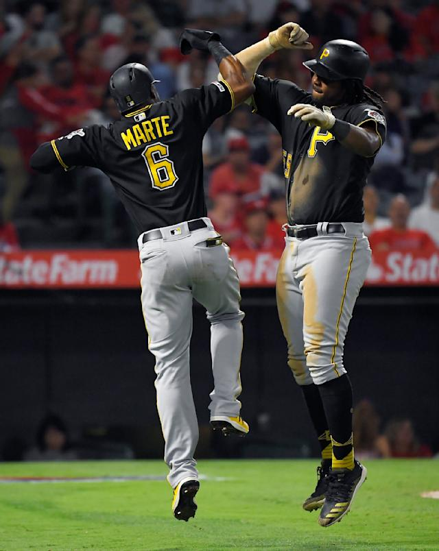 Pittsburgh Pirates' Josh Bell, right, is congratulated by Starling Marte after hitting a two-run home run during the fifth inning of the team's baseball game against the Los Angeles Angels on Tuesday, Aug. 13, 2019, in Anaheim, Calif. (AP Photo/Mark J. Terrill)