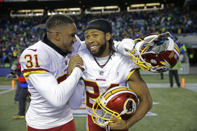 Washington Redskins cornerbacks Josh Norman, right, and Fabian Moreau, left, celebrate after holding off a late comeback by the Seattle Seahawk  (AP Photo)