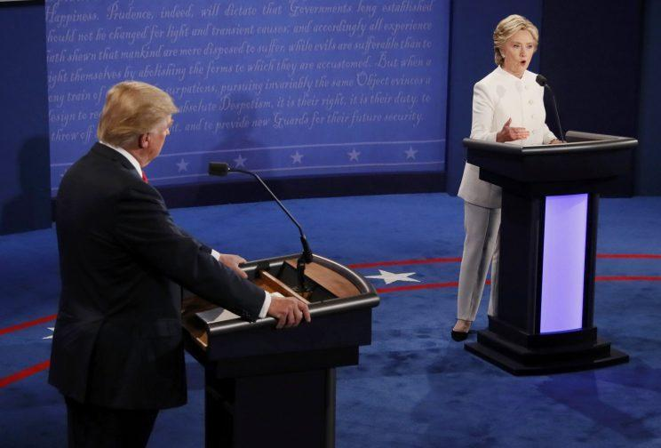 Donald Trump listens as Hillary Clinton speaks during their third and final debate. (Photo: Mark Ralston/Reuters)