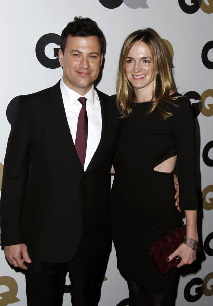 "FILE - This Nov. 17, 2011 file photo shows late night talk show host Jimmy Kimmel, left, and Molly McNearney arrive at the 16th annual GQ ""Men of the Year"" party in Los Angeles. Kimmel and McNearney are newly engaged. His spokesman, Lewis Kay, said Wednesday, Aug. 15, 2012, that Kimmel popped the question during a recent vacation in South Africa's Kruger National Park. McNearney is the co-head writer for the network's ""Jimmy Kimmel Live."" They started dating in 2009, after Kimmel's breakup with comic Sarah Silverman. (AP Photo/Matt Sayles)"