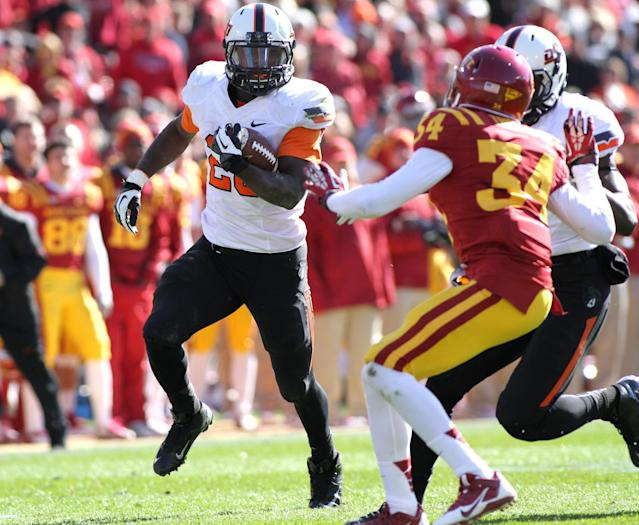 Oklahoma State running back Desmond Roland looks for a block on a long touchdown run during the second half of an NCAA college football game against Iowa State in Ames, Iowa, Saturday, Oct. 26, 2013. Oklahoma State won 58-27. (AP Photo by Justin Hayworth)