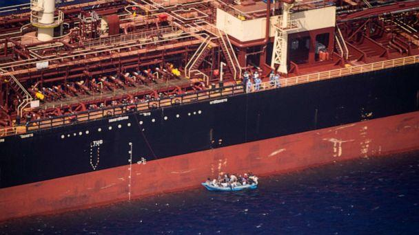 PHOTO: An aerial view shows migrants sitting in a boat alongside the Maersk Etienne tanker off the coast of Malta, Aug. 19, 2020. (Kai Von Kotze/Sea Watch/via Reuters)