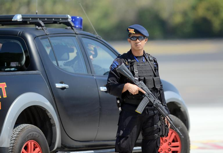 An Indonesian anti-terror police officer stands guard at Ngurah Rai Airport on the resort island of Bali, on October 4, 2013