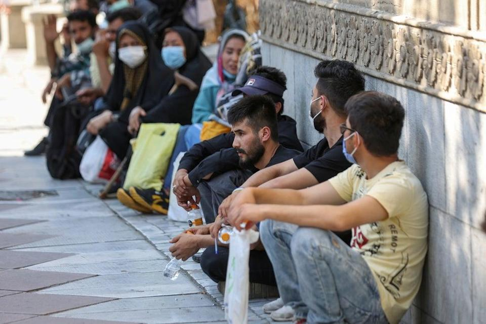Afghan nationals gather in front of the German embassy in Tehran  (VIA REUTERS)